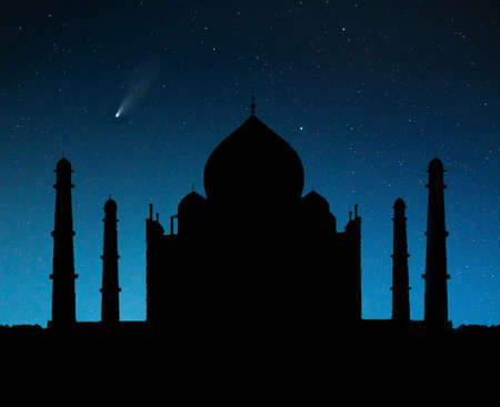 Taj Mahal tomb silhouette at night sky with stars and flying comet in Agra, Uttar Pradesh, India. Free space for your text