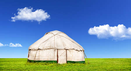 Yurt traditional nomadic house in central Asia on steppe at blue sky with clouds on Nauryz festival Stock Photo