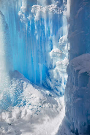 Frozen mountain waterfall with icicles texture close up in Kazakhstan Stock Photo