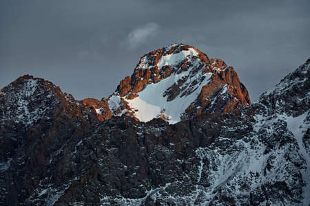 Beautiful scenery of the mountains summit with glacier and snow in Almaty, Kazakhstan. Outdoor and hiking concept