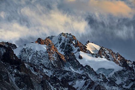Beautiful scenery of the mountains summit with glacier and snow in Almaty, Kazakhstan. Stock Photo