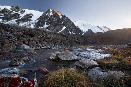 Beautiful scenery of the river and mountains summit with snow in Almaty, Kazakhstan. Outdoor and hiking concept Stock Photo