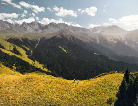 Aerial view of small tourist in the beautiful mountain valley at sunny day.