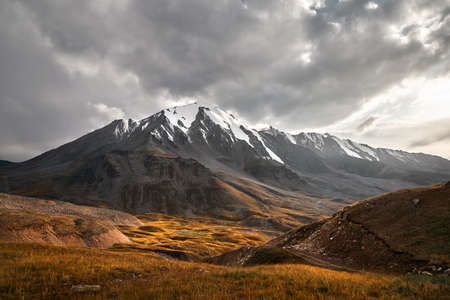 Landscape of beautiful summit in Tian Shan Mountains Valley at sunset in Almaty, Kazakhstan
