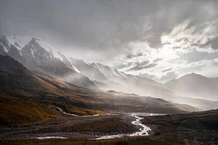 Landscape of beautiful landscape of Tian Shan Mountains Valley at sunset after strong rain in Almaty, Kazakhstan
