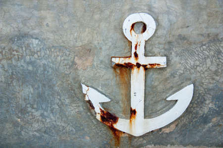 Old anchor on  wall background
