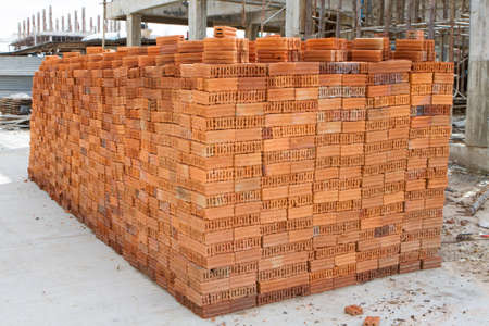 red clay: A stack of red clay bricks Stock Photo