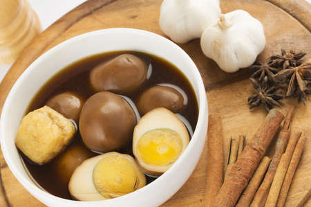 Hard-boiled egg and pork stew with sweet gravy, Kai Palo, thai cuisine photo