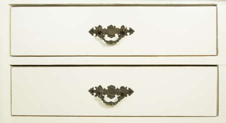 Isolated white wooden chest of drawers photo