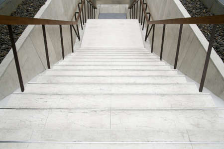 Modern white stairs with wooden handrail photo
