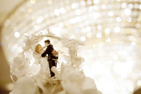 Miniature wedding doll with chandelier background