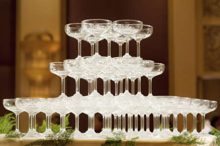 Champagne glasses in wedding party photo