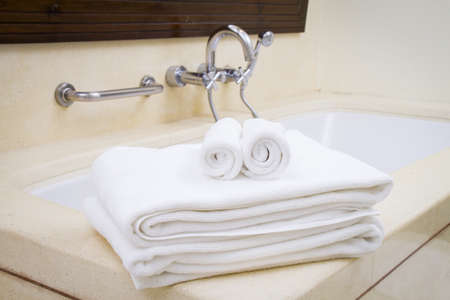Stacked and roll up white spa towels Stock Photo