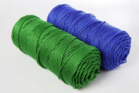 Rolls of green and blue polyester rope - close up photo