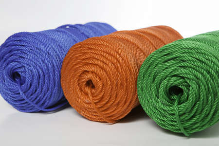 Rolls of green, blue and red polyester rope - close up photo