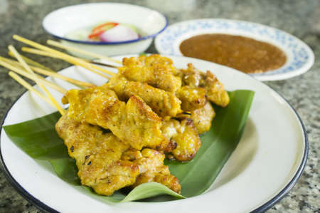 malaysian food: Grilled Pork Satay with Peanut Sauce and Vinegar Stock Photo