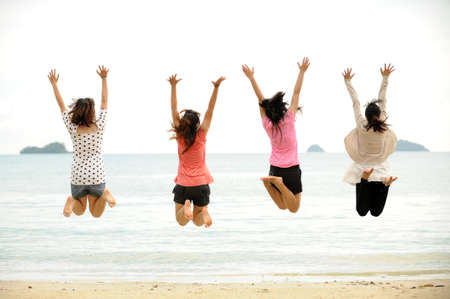 Group of jumping teenager people photo