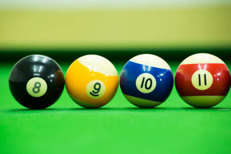 number eleven: Pool game on green table Stock Photo
