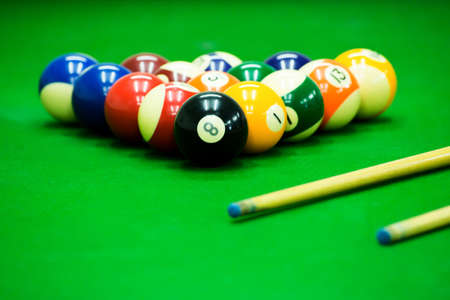 Pool game on green table Imagens