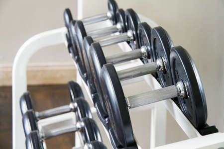 Sports dumbbells in modern sports club. Weight Training Equipment photo