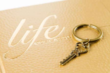 A golden key on bible photo
