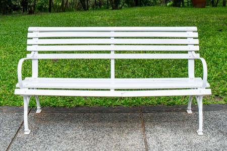 A white chair in a green garden Stock Photo - 22978371