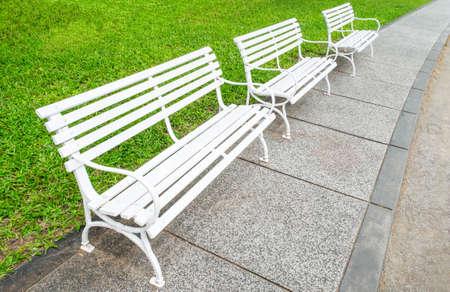 A white chair in a green garden Stock Photo - 22978660