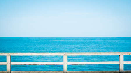 Summer view with classic fence beside the beach Stock Photo