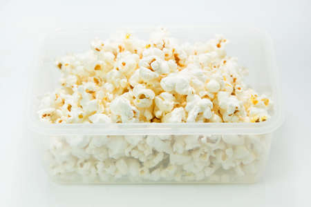Popcorn in box isolated on white background photo