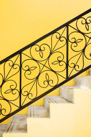 Ornate handrail of wrought iron