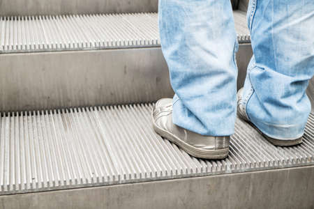 Man's foot on escalator photo