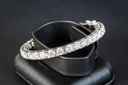 Diamonds bracelet in black background photo