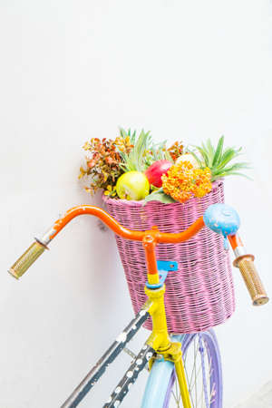 Vintage bicycle with a basket of flowers photo