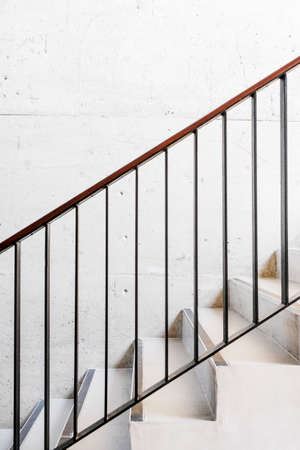 Concrete stairs with iron handrail photo