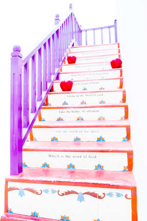 colorful stairs with wooden handrail isolate on white background photo