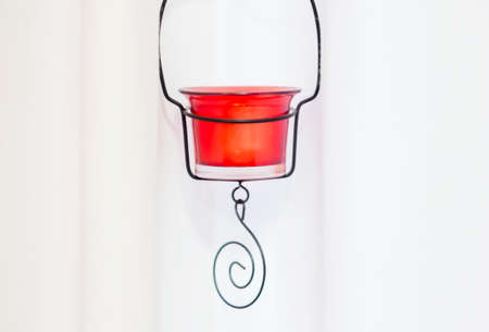 red candle holder on white background photo