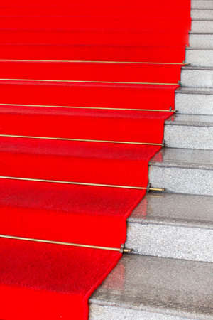 Red carpet on a stairway photo
