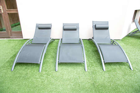 deck chairs: A row of stylish deck chairs Stock Photo