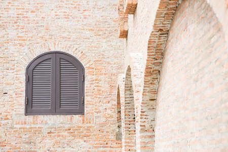 Brown wooden window on brick wall photo