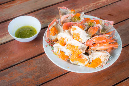 crabs with spicy seafood sauce in Thai style photo