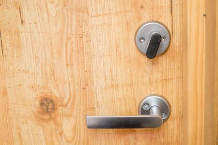 handle with lock on wooden door photo