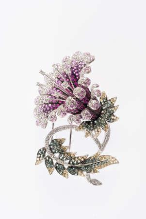 flower brooch on white background