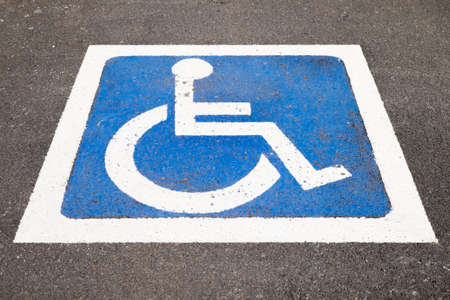 paraplegia: disabled parking sign painted on tarmac