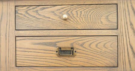 drawers of a chest of drawers with knobs, soft wood, tidines Stock Photo