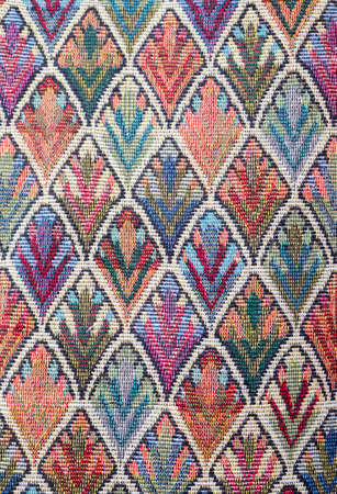 thai silk handcraft peruvian style rug surface close up More this motif & more textiles peruvian stripe beautiful background tapestry persian nomad detail pattern farabic fashionable textile. Stock Photo