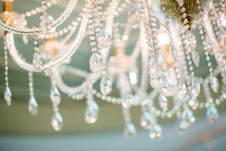 chandelier in classic room shining Stock Photo
