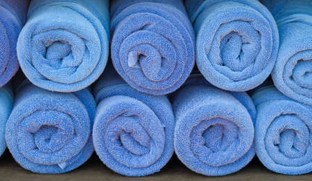 absorb: Rolled up blue spa towels Stock Photo