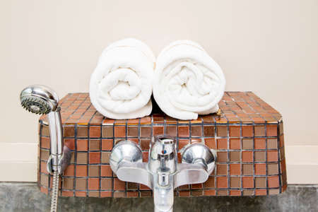absorb: Rolled up white spa towels Stock Photo