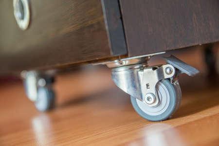 Standing small metal furniture wheel