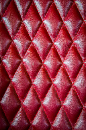 cushioning: Closeup texture of vintage red leather sofa for background